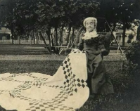 Historic photograph of a woman in the park with a quilt Courtesy of Roderick Kiracofe