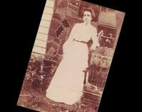 Historic photograph of a woman in front of a quilt In upcoming book by Schiffer Publishing,  Atglen, Pennsylvania; late 2012 Collection of Janet E. Finley