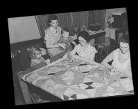 A quilting party in an Alvin, Wisconsin, home May 1937 Photo by Russell Lee Library of Congress Prints & Photographs Division Farm Security Administration Office of War Information Photograph Collection Washington, D.C. Item number LC-USF34-010885-D www.loc.gov/pictures