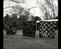 Quilts on the clothesline, Mary Lee Bendolph's Yard 2006 From Gee's Bend: The Architecture of the Quilt Paul Arnett, Tinwood Books, 2006  Courtesy of Matt Arnett Photo by Pitkin Studio