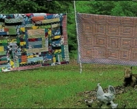 Quilts on clothesline at Polly Bennett\'s house,  Alabama Route 5, Near Alberta 2001 From Gee\'s Bend: The Women and Their Quilts Tinwood Books, 2002 Courtesy of Matt Arnett Photo by Matthew Arnett