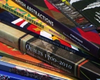 Stack of quilt exhibition books Photo by Focal Point
