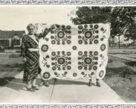 Historic photograph of a woman with a quilt Courtesy of Roderick Kiracofe