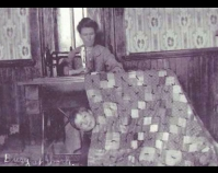 Historic photograph of woman sewing  with child peeking from behind the quilt In upcoming book by Schiffer Publishing, Atglen,  Pennsylvania; late 2012 Collection of Janet E. Finley