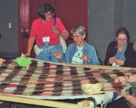 Women quilting Photo by Kim Coffman Quilts, Inc. and International Quilt Festival Houston, Texas www.quilts.com