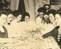 Historic photograph of a quilting party in a home In upcoming book by Janet E. Finley Schiffer Publishing, Atglen, Pennsylvania; late 2012 Collection of Janet E. Finley