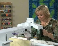 Quilting with an Avante longarm sewing machine  Courtesy of Handi Quilter, Inc.  North Salt Lake, Utah  www.HandiQuilter.com