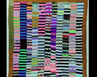 "Strip Quilt Idabell Bester c. 1993 Cott on 85 "" x 74 "" Item number 2000.004.0017 Robert and Helen Cargo Collection The International Quilt Study Center & Museum University of Nebraska - Lincoln Lincoln, Nebraska www.quiltstudy.org"