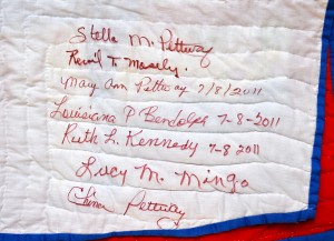 The picture of the inscriptions from the Gee's Bend quilters, including Lucy's signature.