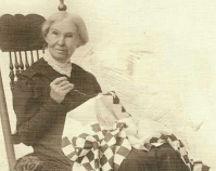 Historic photograph of a woman quilting  In upcoming book by Janet E. Finley, Schiffer Publishing,  Atglen, Pennsylvania; late 2012 Collection of Janet E. Finley