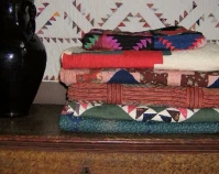 Stack of quilts Susan Parrett and Rod Lich  Georgetown, Indiana