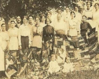 Historic photograph of group of people holding a quilt In upcoming book by Schiffer Publishing,  Atglen, Pennsylvania; late 2012 Collection of Janet E. Finley