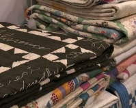 Stack of quilts Heart of Country Antique Show  Nashville, Tennessee B-roll by Alan Miller