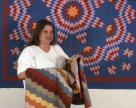 Sandra Mitchell holding a quilt Sandra Mitchell Archives Courtesy of Shelly Zegart