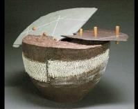 "Subduction Caldron Walter Hyleck 2007 Ceramic, black earthenware, deflocculated slip, ash  glaze, slate, oak 14\"" x 14\"" x 12\"" Courtesy of the Kentucky Museum of Art & Craft Louisville, Kentucky www.kentuckyarts.org"