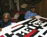 Mary Lee Bendolph and Loretta Pettway quilting  Bendolph\'s quilt top in her home 2005 From Gee\'s Bend: The Architecture of the Quilt Paul Arnett, Tinwood Books, 2006  Courtesy of Matt Arnett Photo by Matt Arnett