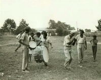 Musicians playing in field From Mississippi Blues history presentation Courtesy of William Ferris