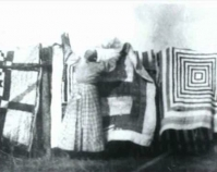 African American quilts, vicinity of the Alabama River  (possibly Gee\'s Bend), Wilcox County, Alabama c. 1900 From Gee\'s Bend: The Architecture of the Quilt Paul Arnett, Tinwood Books, 2006  Courtesy of Matt Arnett Photo by Edith Morgan