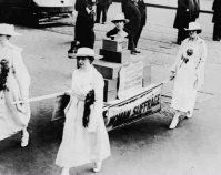 Four women carrying ballot boxes on a stretcher during a  suffrage parade in New York City, New York Oct. 23, 1915 Library of Congress Prints & Photographs Division  Bain Collection Washington, D.C. Item number LC-USZ62-132968 www.loc.gov/pictures
