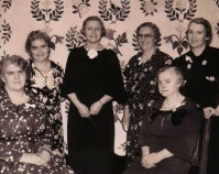 Chicago master quilter Mary Gasperik is standing at the left,  in front of her Laurel Wreath quilt and behind Tuley Park  quilt club president, Virgie Stewart Tuley Park exhibition 1930s Tuley Park Quilt Club Photo by Chicago Park District Chicago, Illinois Courtesy of Susan Salser