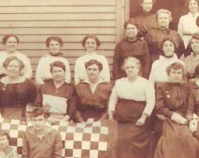 Historic photograph of group of women with a quilt In upcoming book by Janet E. Finley, Schiffer Publishing, Atglen, Pennsylvania; late 2012 Collection of Janet E. Finley