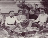 Historic photograph of group of women holding a quilt In upcoming book by Janet E. Finley, Schiffer Publishing, Atglen, Pen nsylvania; late 2012 Collection of Janet E. Finley