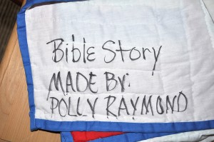 A picture of the Polly Raymond inscription on the back of the quilt