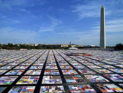 The AIDS Quilt Project on the Mall in Washington, DC; the AIDS quilt is made up of thousands of 3' x 6' panels, each made by family members and friends in memory of a loved one lost to AIDS. The AIDS Quilt Project is featured in Episode 7 of Why Quilts Matter: History, Art & Politics.