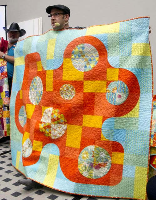 Thomas Knauer shows the  'Displacement Activity' quilt by Dan Rouse